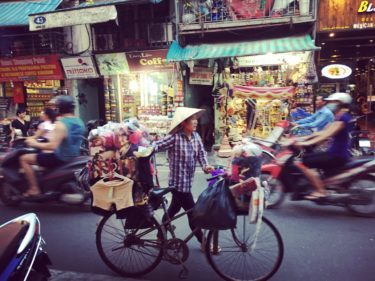 new perspectives travel vietnam tour market woman pushing bike